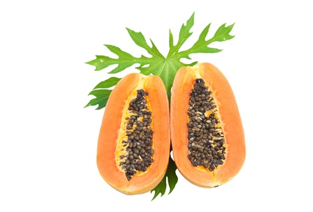 Ripe papaya with seeds and green leaf