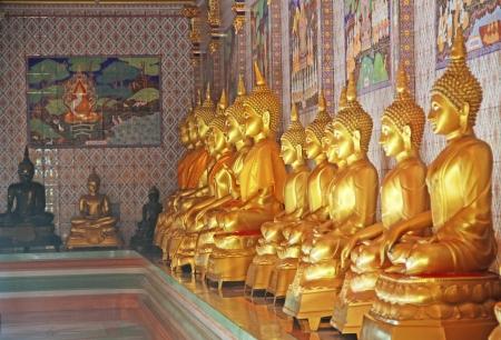 Meditating Row of Buddhas Editorial