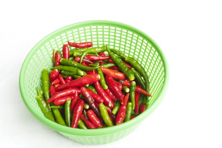 Red and green hot pepper in the basket Stock Photo