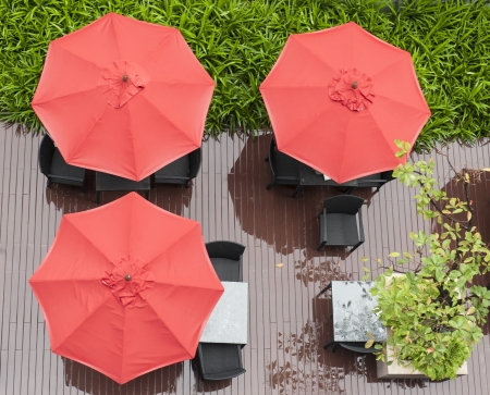 red umbrellas and chairs photo