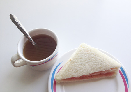 Hot tea and snacks are sandwiches to eat for breakfast. Lunch or dinner photo