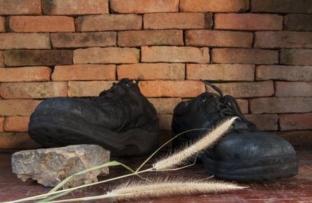 Still life with Hiking boots and work Stock Photo