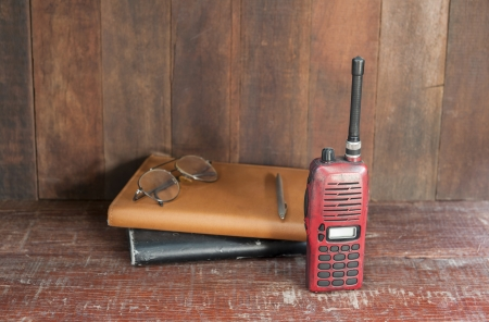 short wave: radio communication and notebook for taking notes.