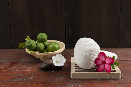 herbal compress ball with flower and limes Stock Photo
