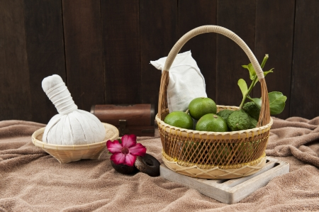 herbal compress ball and limes in a basket