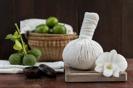 herbal compress ball with limes in a basket photo