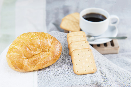 Coffee with bread or cookies for breakfast.