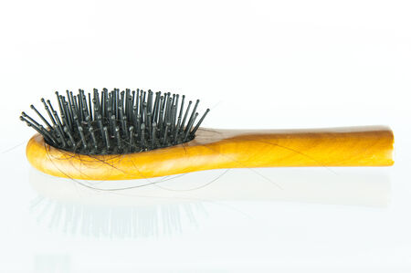 Female hair loss on the comb Stock Photo