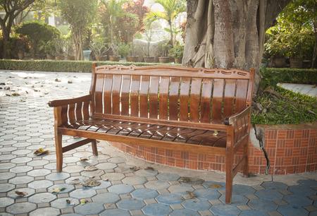Brown wooden chair in the garden