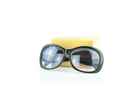 sunglasses and  Yellow gift box on the white background