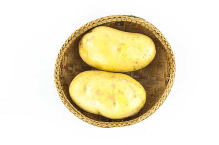 Potatoes in a basket on a white background