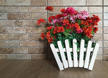 Potted flowers on a background of stone Stock Photo