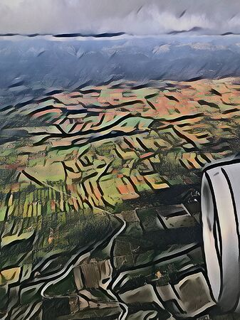 View from a plane onto fields and mountains, illustrated and artistic picture in the style of a painted canvas Stok Fotoğraf