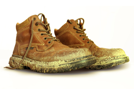 poky: muddy boots Stock Photo