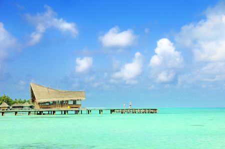 thatched house at maldives photo
