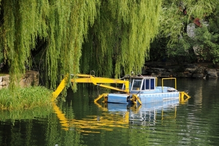 Picture of  a parking river excavator at river  photo