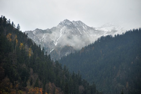Picture of Snow Mountain covered by Mist  photo