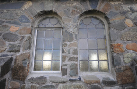 church window: Picture of the window of church at stone wall