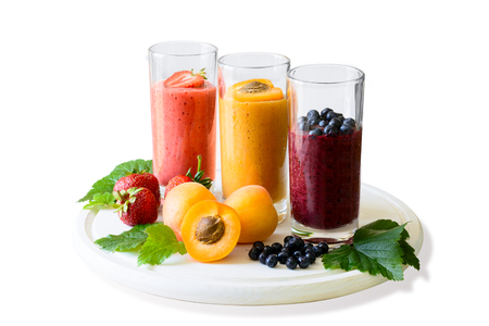 Isolated strawberry, blueberry and apricot smoothies. Detox and healthy eating concept