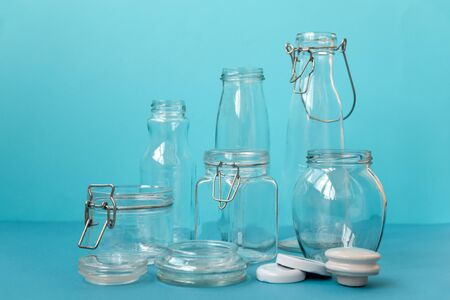Glass jars standing on blue background. Eco friendly, reuse or zero waste concept.