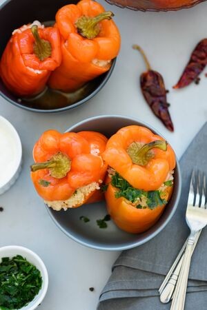 Colorful stuffed peppers on gray wooden background. Selective focus. Healthy food concept
