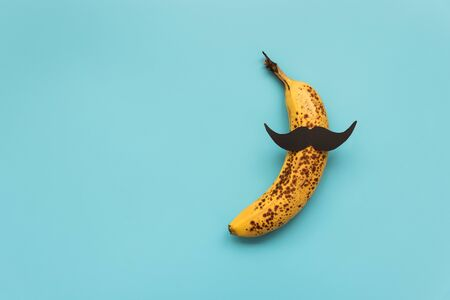 Bad banana with black paper mustache. Sexually transmitted diseases concept. Stock Photo