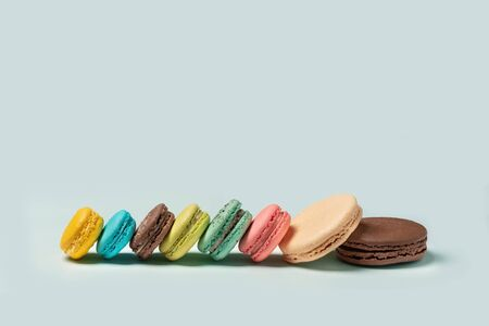 French macaroons on turquoise background. Flat lay. Front view. Selective focus Stok Fotoğraf