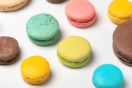 Pattern from French macaroons on white background. Flat lay. Selective focus Stok Fotoğraf