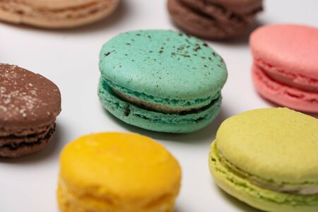 Close-up pattern from colorful French macaroons on white background. Flat lay. Selective focus Stok Fotoğraf