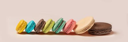 Banner 3:1. French macaroons on pink background. Flat lay. Front view. Selective focus Stok Fotoğraf