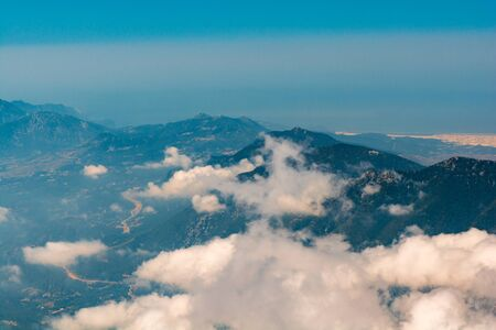 Aerial view from Tahtali peak over Taurus mountains covered clouds. Travel concept
