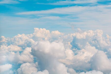 Beautiful natural cloudscape and sky. Aerial view from airplane window