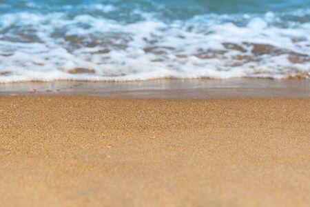 Soft sea wave on sandy beach. Soft focus