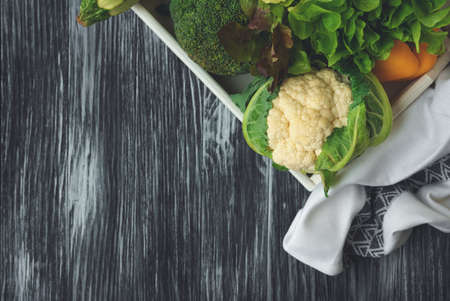 Fresh cauliflower and broccoli on wooden table. Summer food concept. Top view