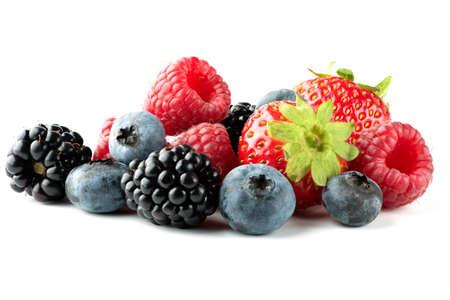 Ripe strawberries, raspberries, blueberries and blackberries isolated on white background. Full depth of field