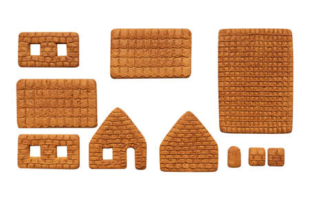 Making gingerbread house for Christmas. Parts of house isolated on white background. Christmas cooking.
