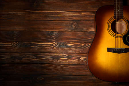 Acoustic guitar on wooden background. Copy space. Top view Archivio Fotografico