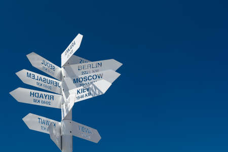 White metal signpost or street sign indicating directions to different places of the world Stock fotó