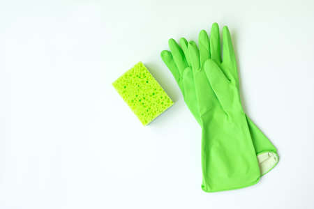 Green kitchen cleaning sponge and gloves on white background. Top view Stock fotó