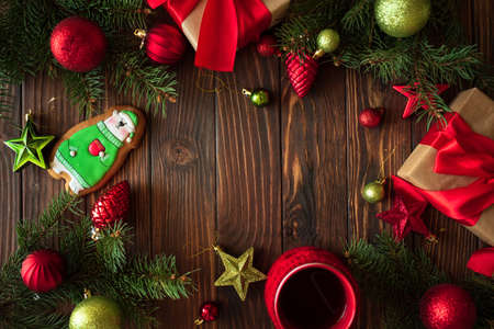 Hot Christmas tea with gingerbread cookie on wooden table. Top view. New Year and Christmas celebration concept. Top view. Flat lay. Mock-up Stock fotó