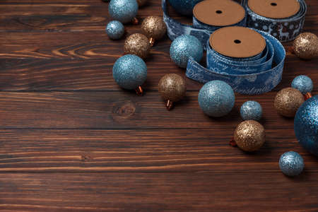 Christmas composition. Christmas balls, blue and silver decorations on blue wooden background. Flat lay. Top view. Copy space