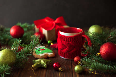 Hot Christmas tea with gingerbread cookie on wooden table. Top view. New Year and Christmas celebration concept.