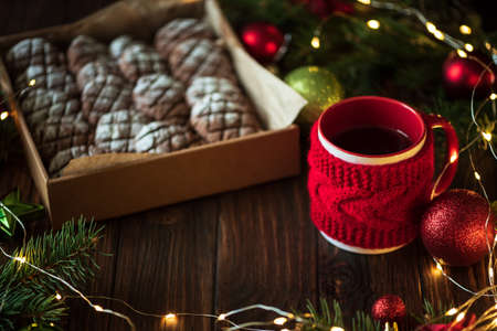Christmas gingerbread cone cookies with Christmas decorations. New Year and Christmas celebration concept. Soft focus. Top view Stock fotó