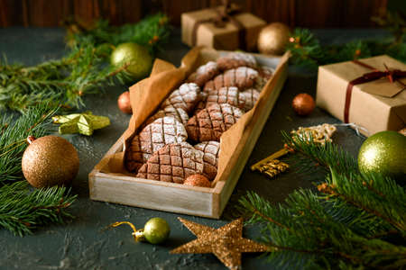 Christmas gingerbread cone cookies into wooden box with Christmas decorations. New Year and Christmas celebration concept. Soft focus Stock fotó