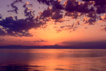 Sunrise over Mediterranean sea and dramatic clouds. Nature background