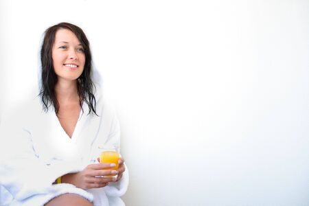 Young smiling woman with orange juice photo