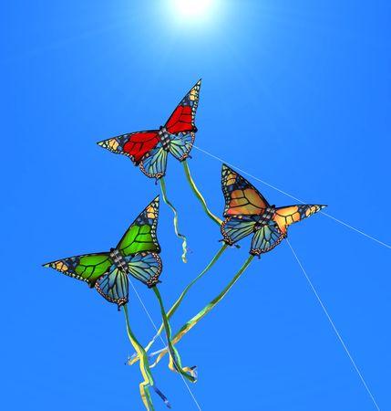 Three colorful kites at sunny sky photo