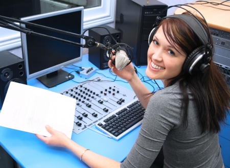 radio station: Radio DJ in the broadcasting studio Stock Photo