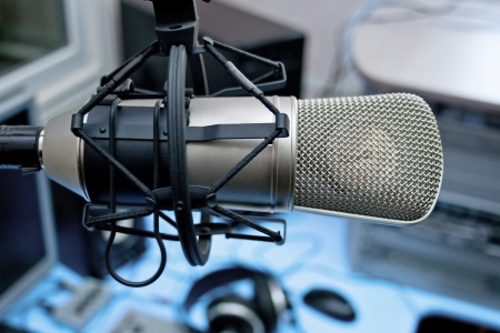 work station: Microphone in broadcasting studio Stock Photo