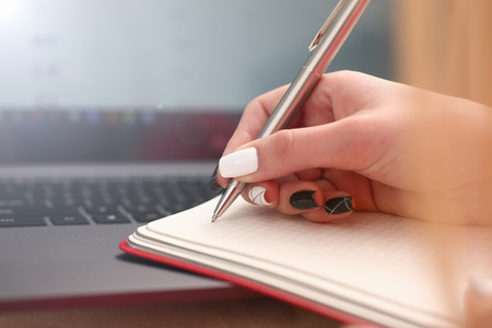 woman study hard write down information to notebook education concept Stock Photo
